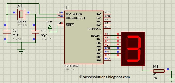 implement free running counter in pic16f84a using seven segment display - schematic